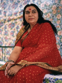 Shri Mataji sitting in pendal, red sari