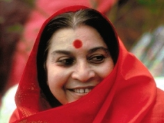 Shri Mataji in red shawl