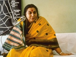Shri Mataji sitting on couch for a speech